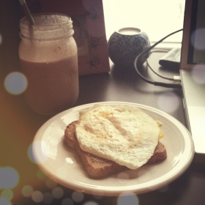 favorite breakfast, ezekiel bread topped with almond butter and an egg